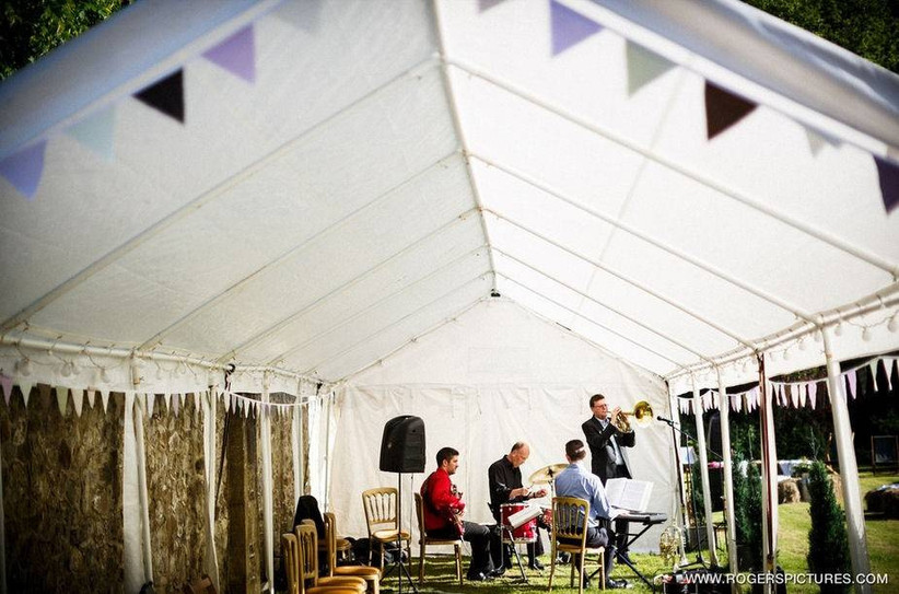 Wedding band playing under a gazebo