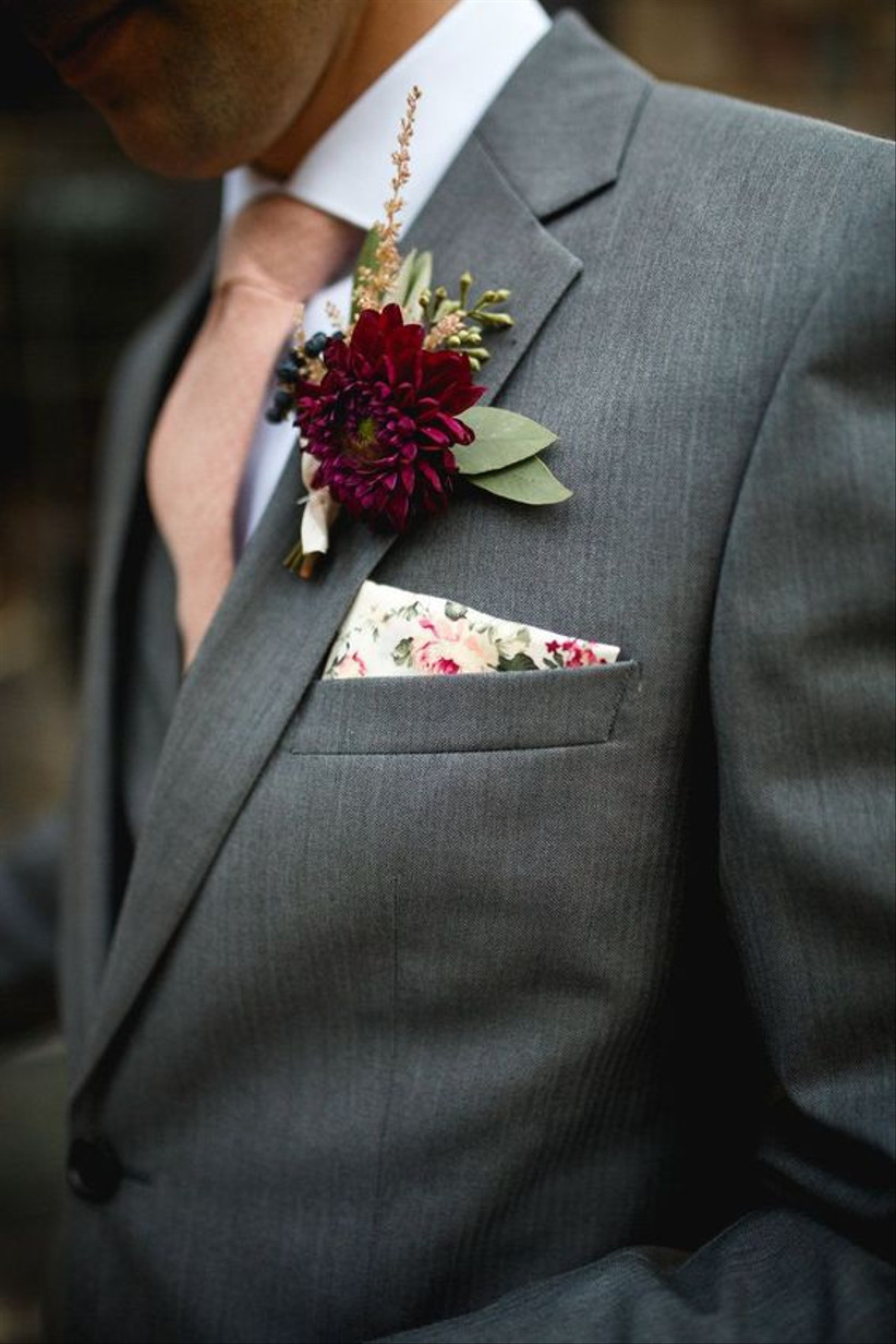 Groom wearing a red floral wedding buttonhole