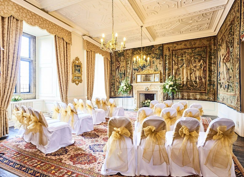 Regal decorated wedding ceremony room with a fireplace