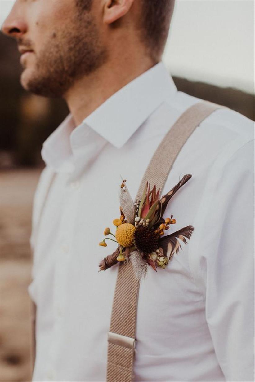 Groom wearing a mustard wedding buttonhole