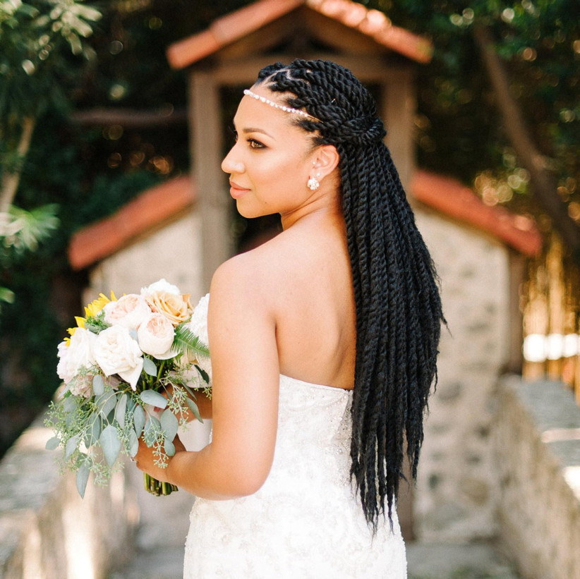 Bride with a half up half down braid hairstyle