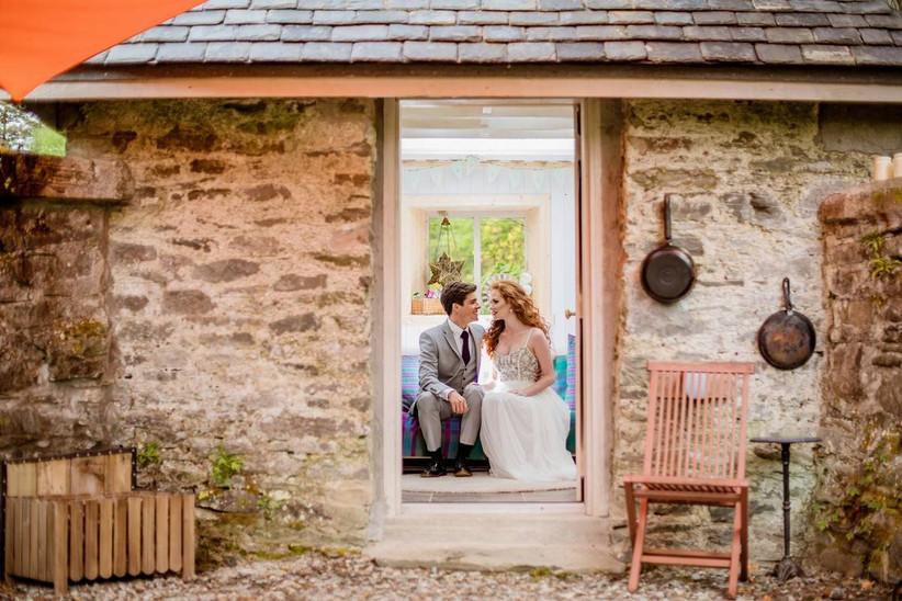 Bride and groom sitting in the doorway