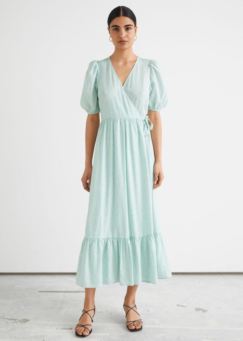 Model wearing a blue wedding guest dress