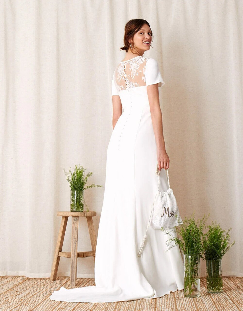 Model in a sleek wedding dress with lace panel
