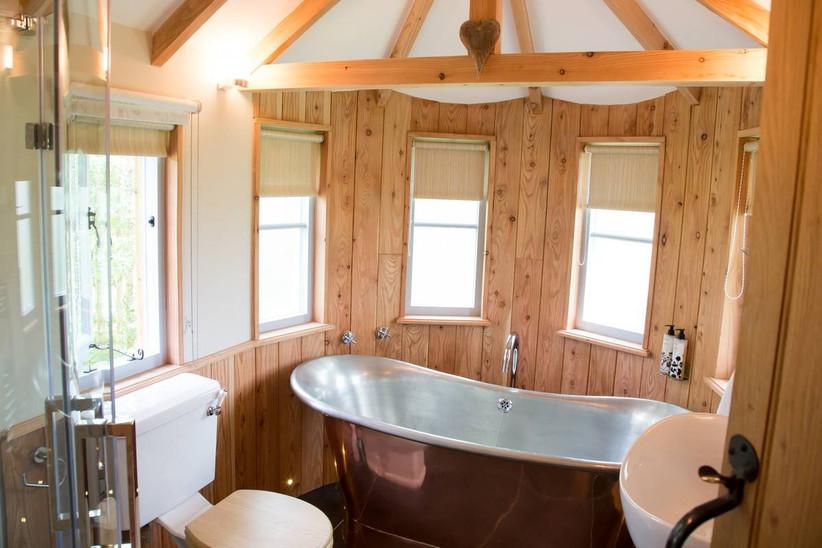 Bathtub in a small treehouse wedding venue