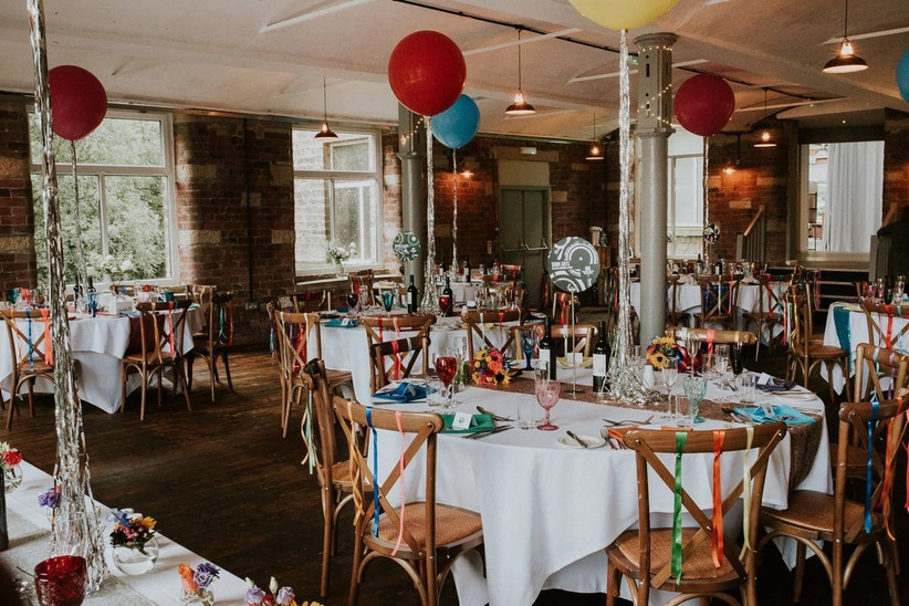 Red and blue balloons in a wedding dining room