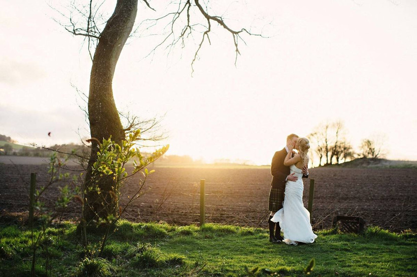 Bride and groom in the countryside at sunset