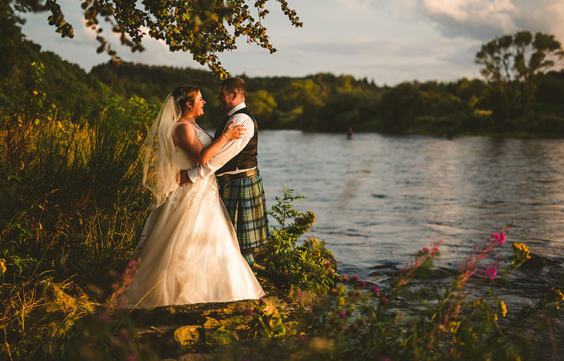 Bride and groom outside a Scottish loch