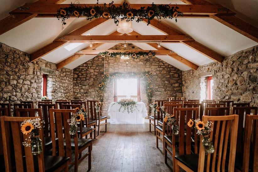 Sunflower decorated barn wedding ceremony