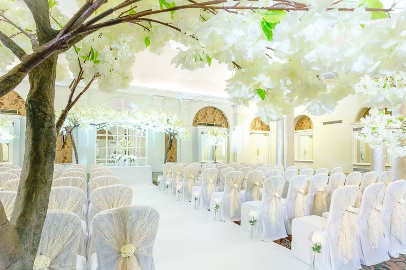White floral decorated wedding ceremony room