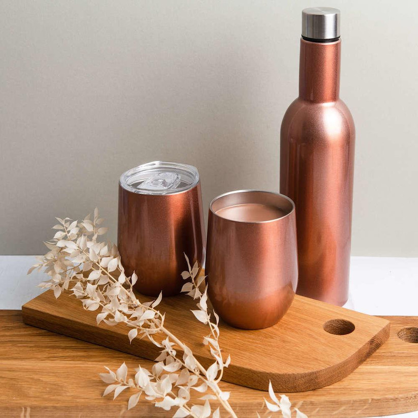 Rose gold wine bottle and tumblers