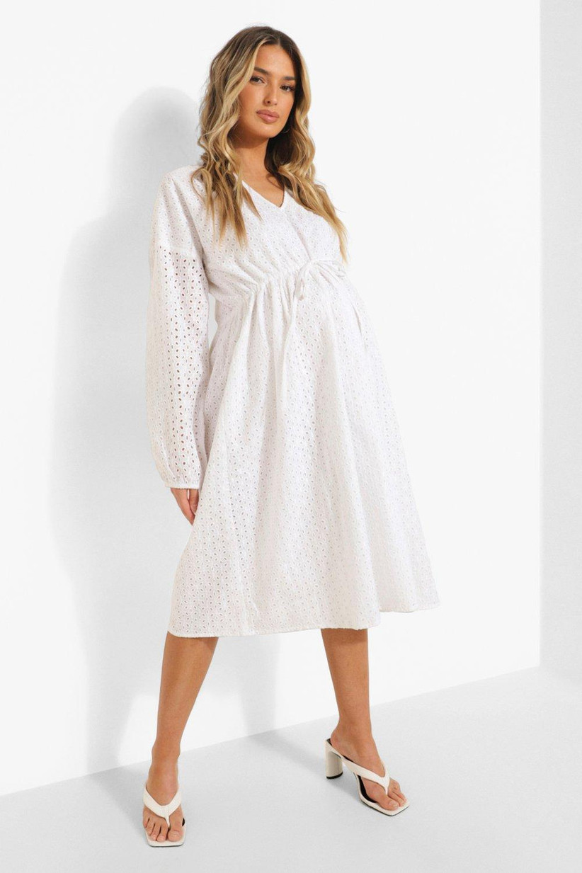 Model wearing broderie anglaise midi dress with long sleeves