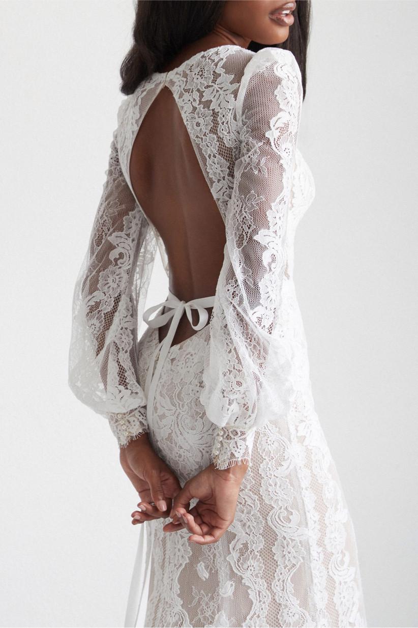 Model wearing a long sleeved lace wedding dress