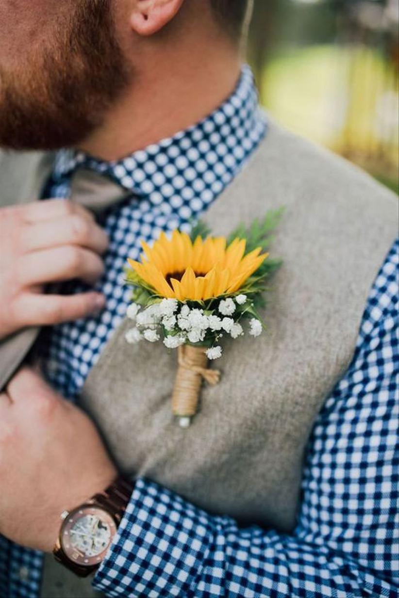 Groom wearing a sunflower wedding buttonhole