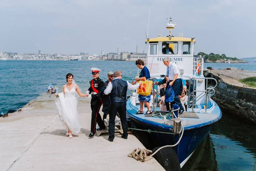 Bride and groom getting off a boat