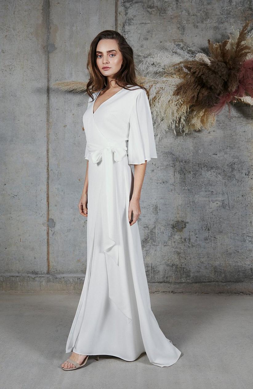 Model wearing a white bridesmaid dress