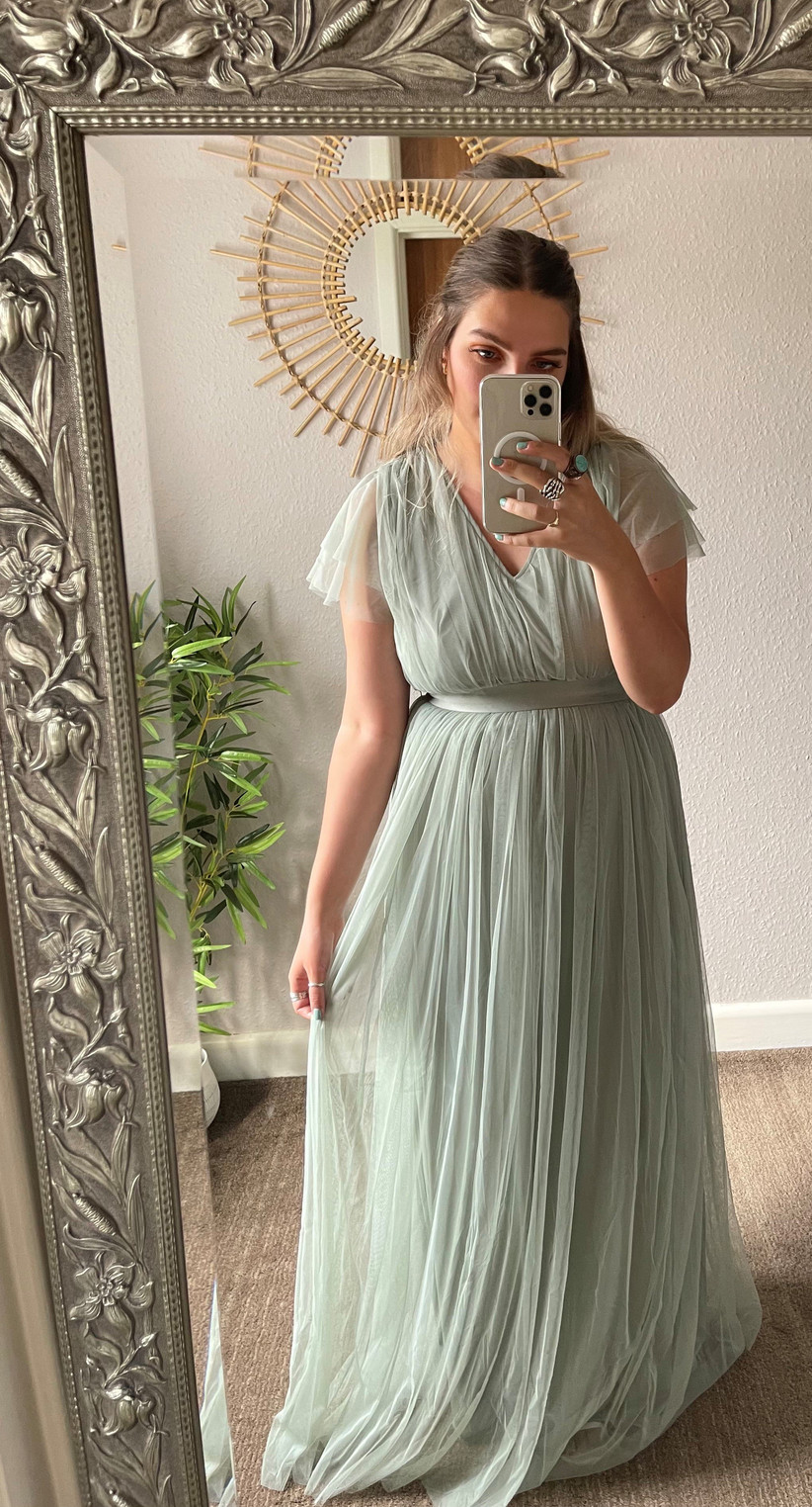 Model wearing a green tulle bridesmaid dress