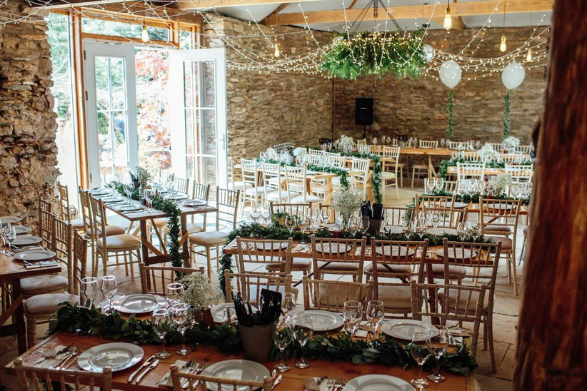 Small wedding venue dining area with tables and chairs