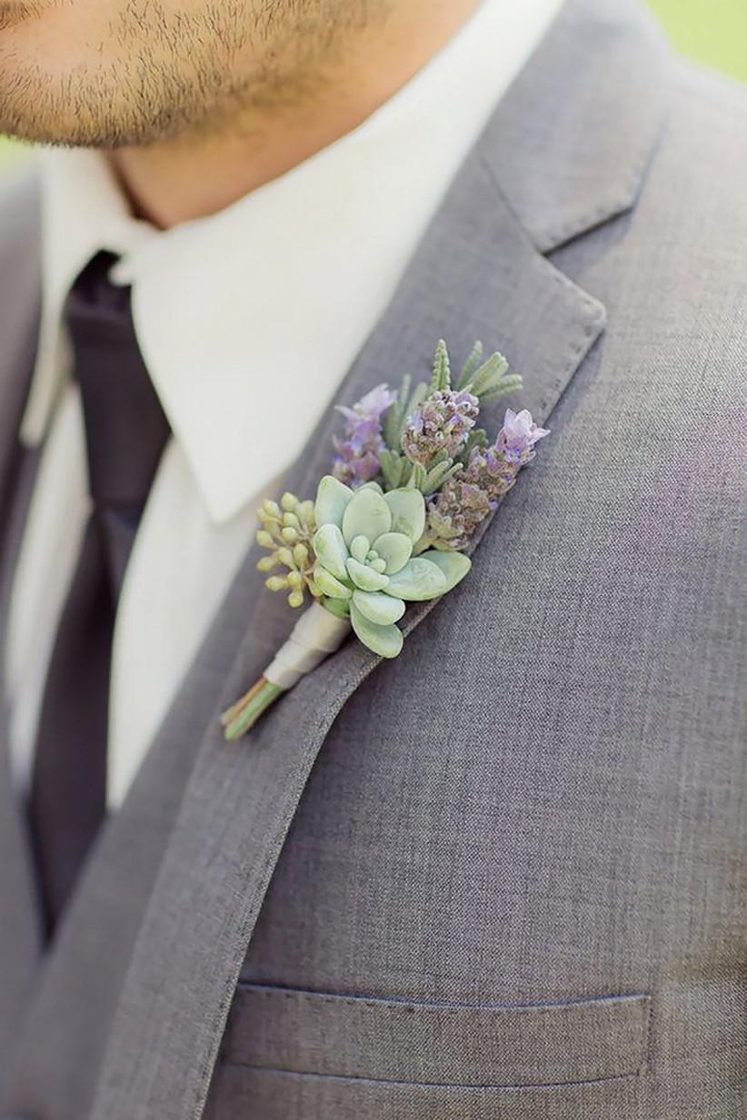 Groom wearing a succulent wedding buttonhole