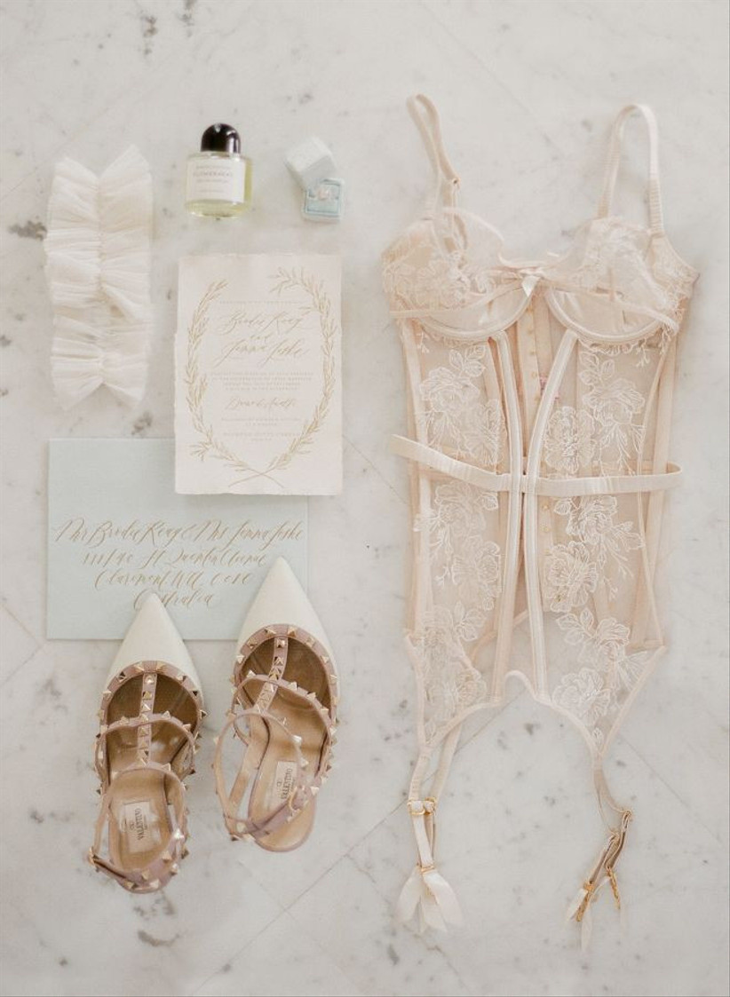Underwear flatlay with perfume