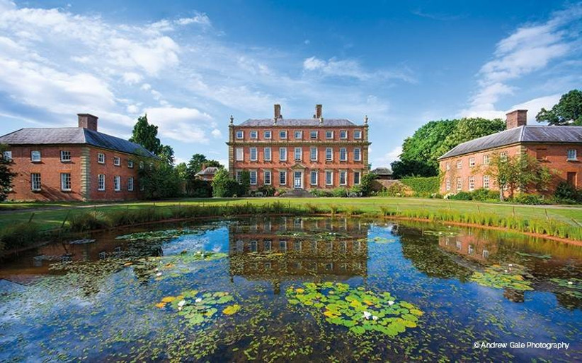 Country house wedding venue with a pond