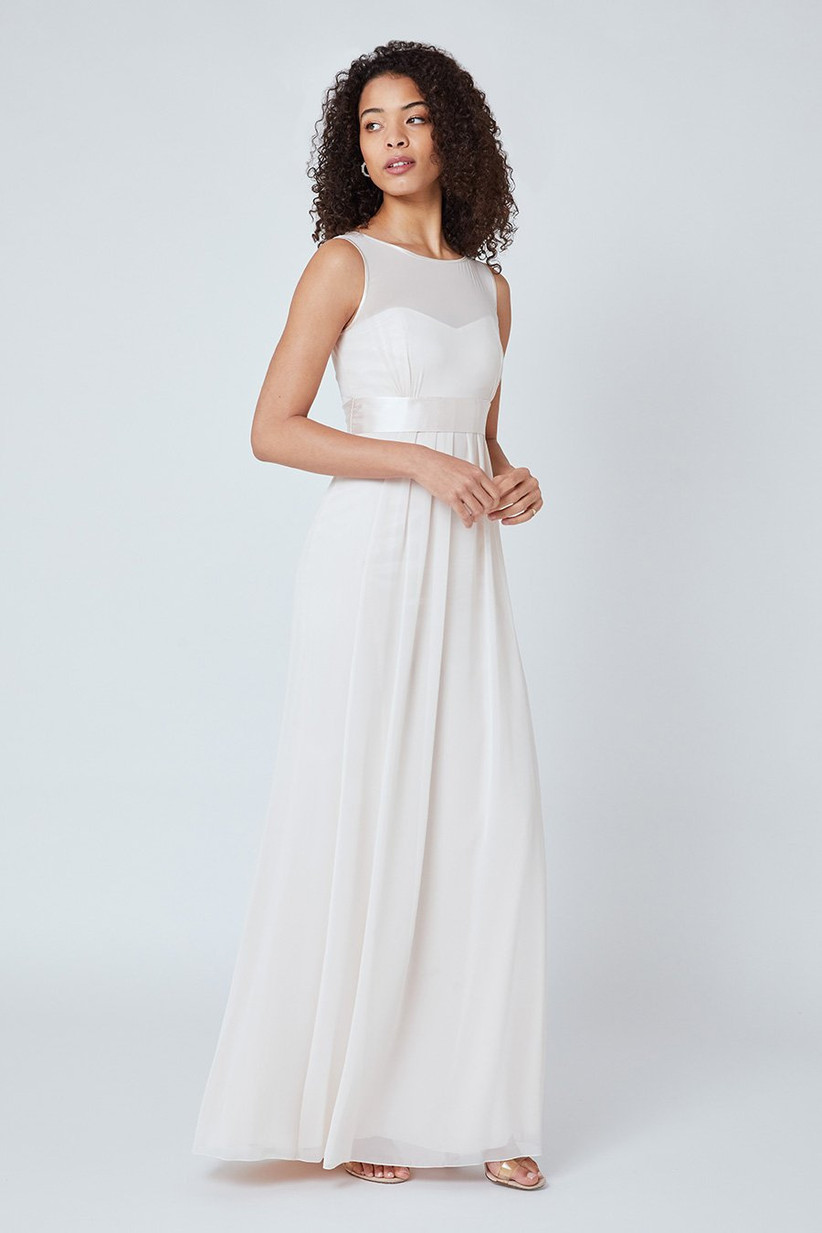 Model wearing a high neck white bridesmaid dress