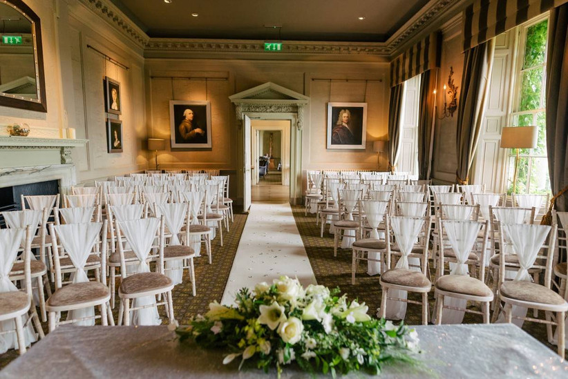 Wedding ceremony room with a fireplace and oil paintings