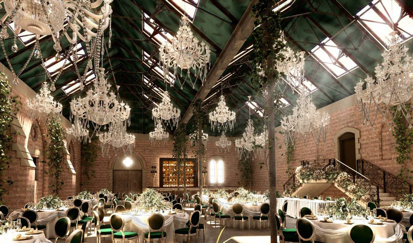 Wedding dining area with hanging chandeliers