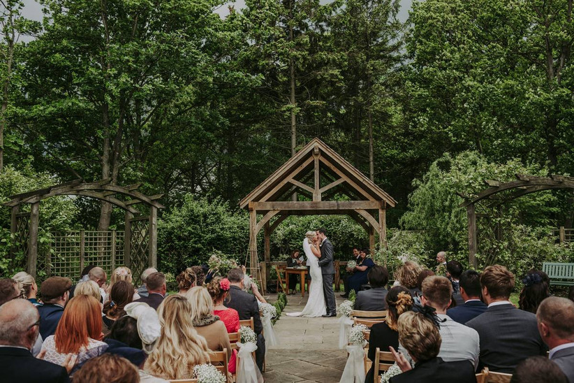 Outside wedding ceremony by trees
