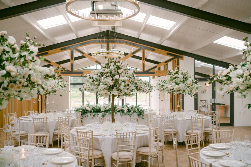 Wedding dining area with white flowers