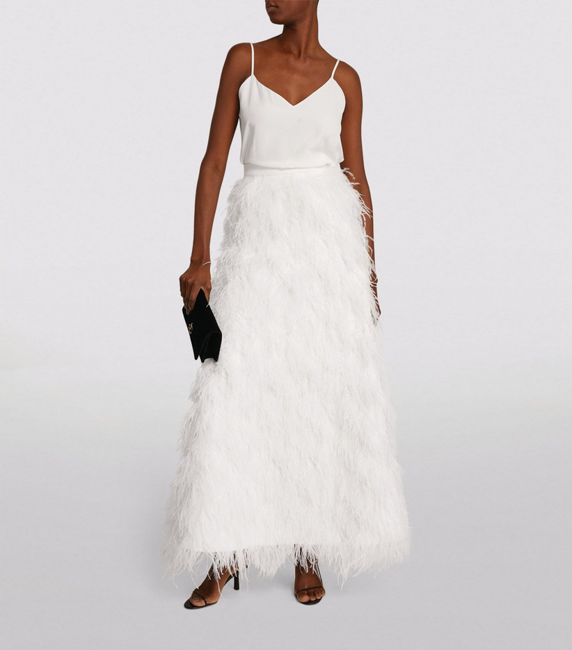 Model wearing a feathered wedding skirt