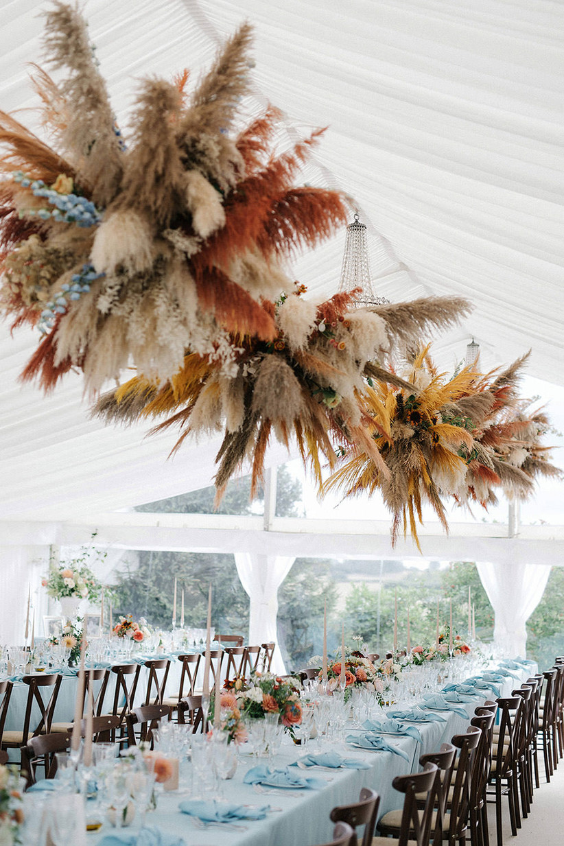 Dried grass display above a wedding table