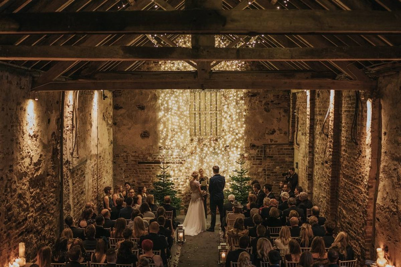 Bride and groom marry at a barn wedding ceremony