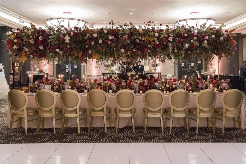 Hanging flower display above a wedding dining table