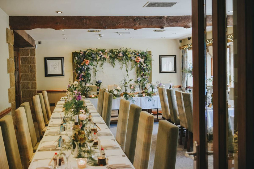 Wedding dining area in an Inn decorated with flowers