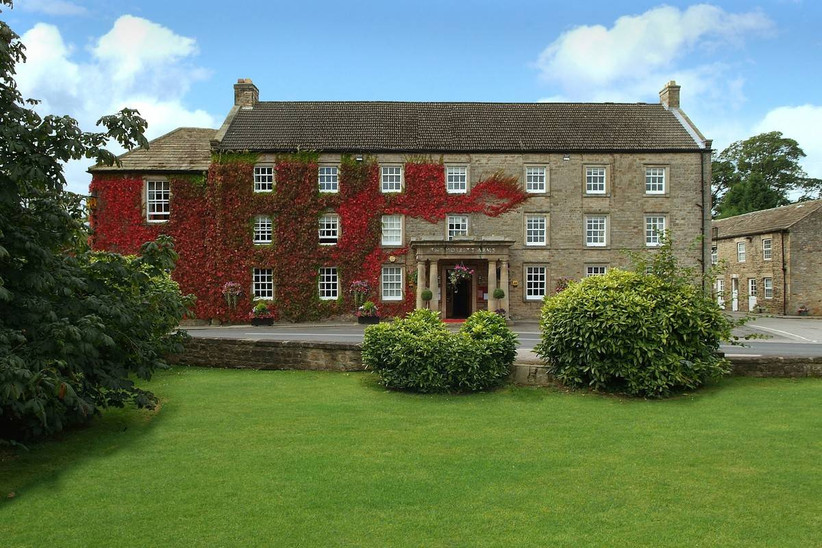 Red ivy covered hotel wedding venue