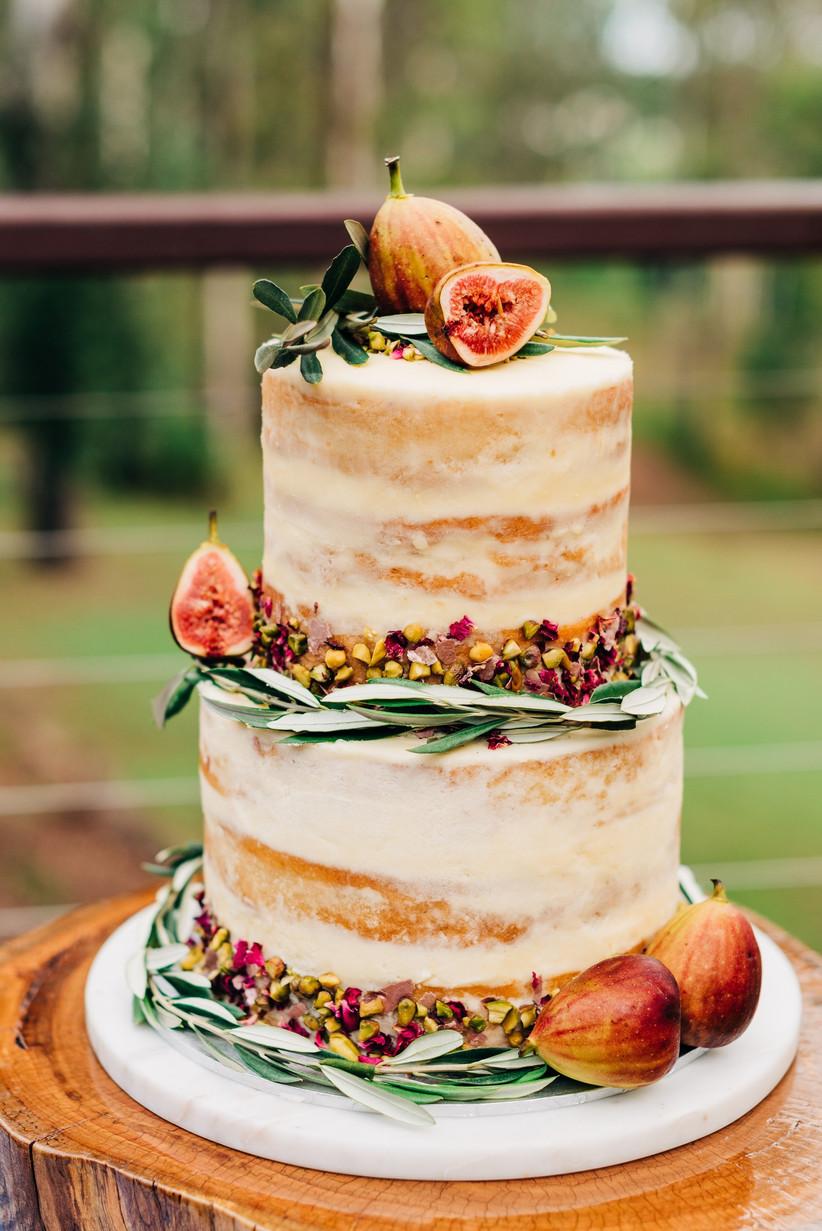Naked wedding cake decorated with fresh figs