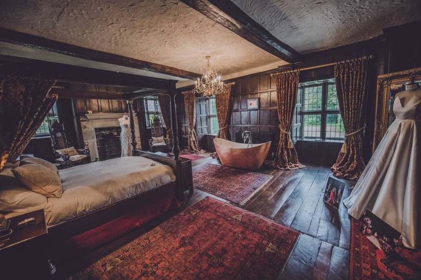 Grand bedroom with bath and wooden floors