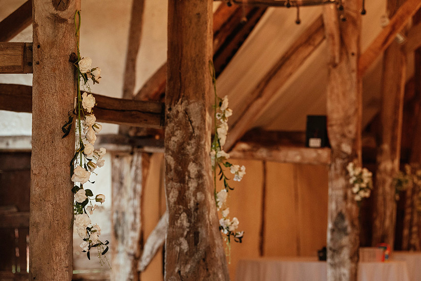 White flowers hanging from oak beams