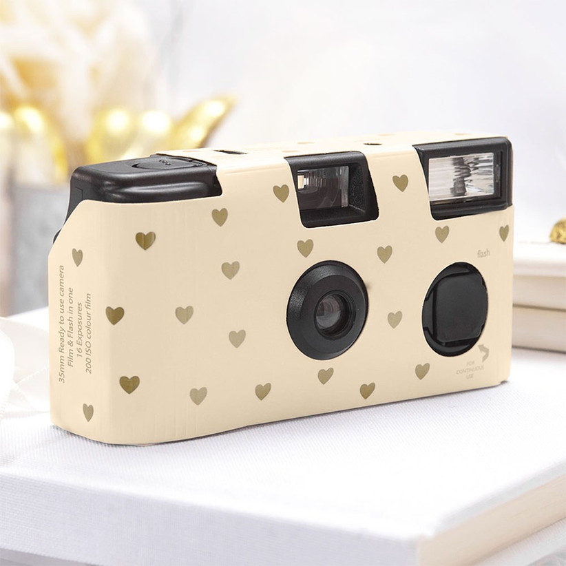 Disposable camera decorated with gold hearts
