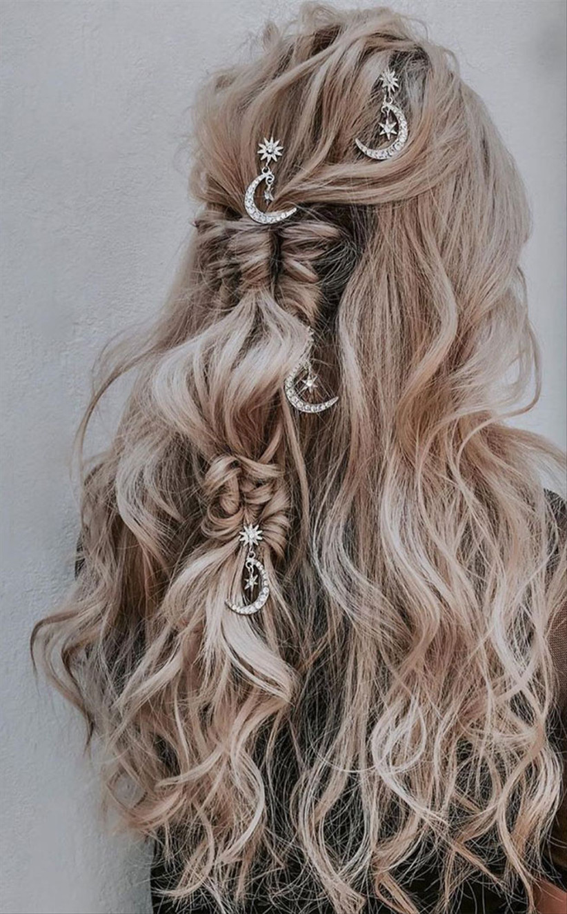 Knotted plaits half up half down hairstyle with moon clips
