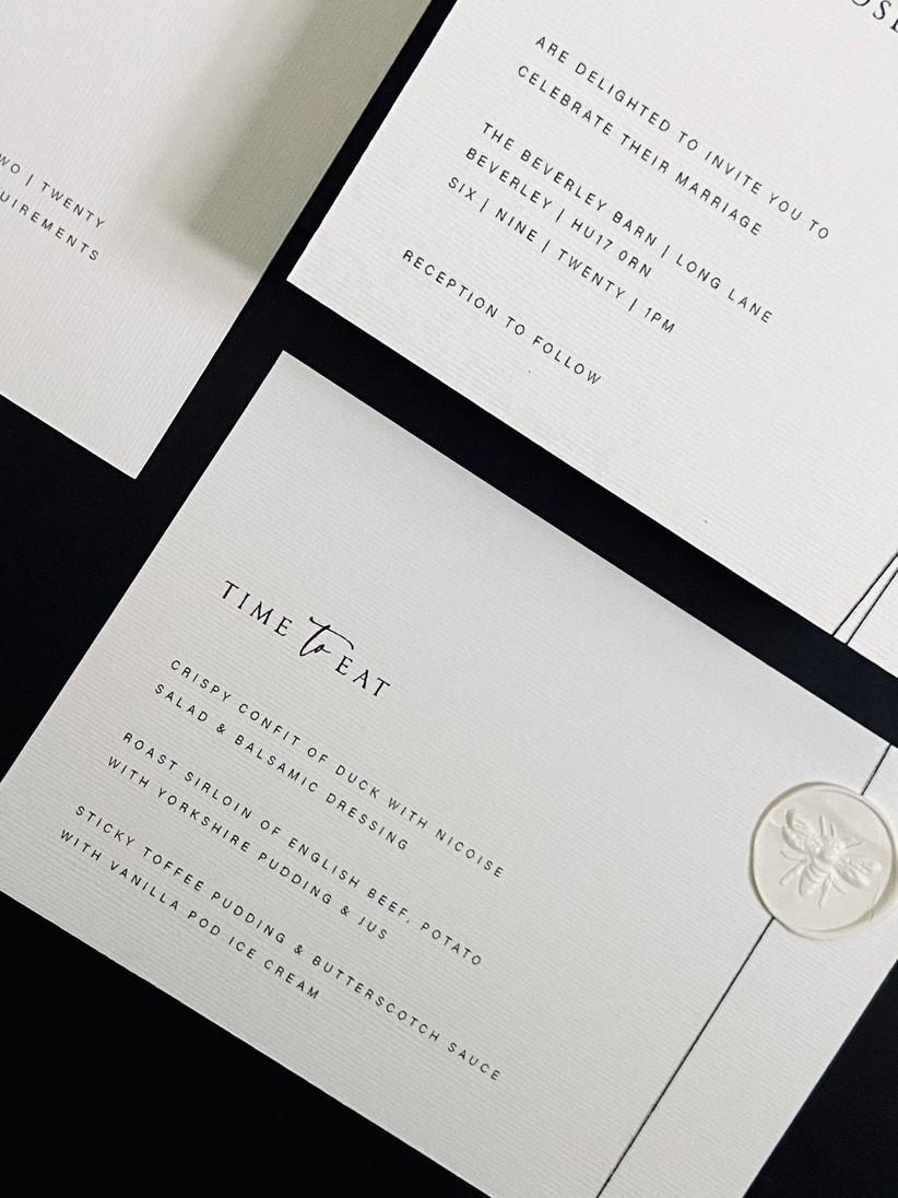 A black and white wedding menu