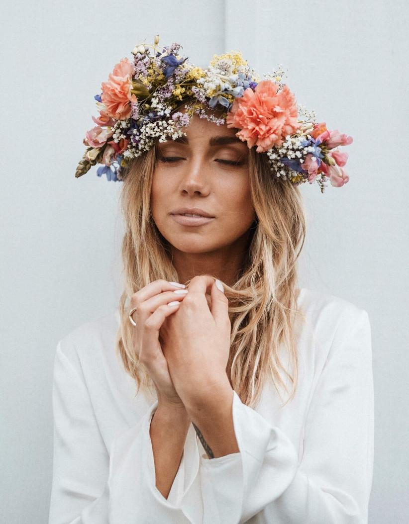 Girl with large flower crown closing her eyes