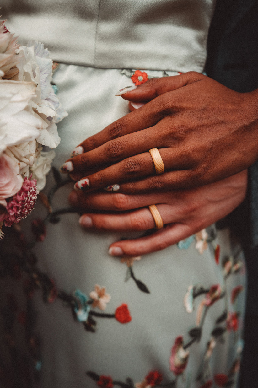 Close-up of the couple's wooden wedding rings