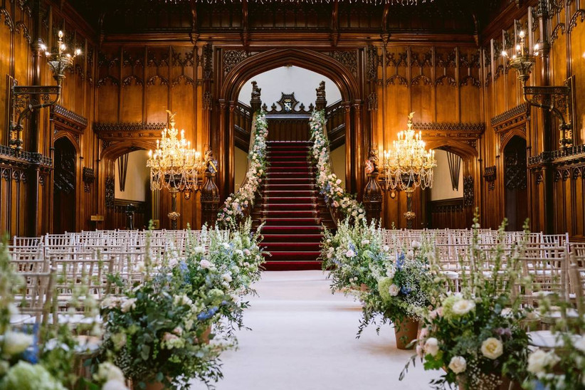 Grand staircase ceremony with floral decorated chairs