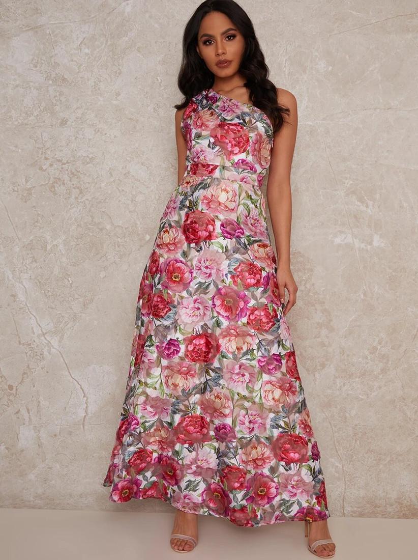 Girl wearing a one shoulder pink floral maxi dress