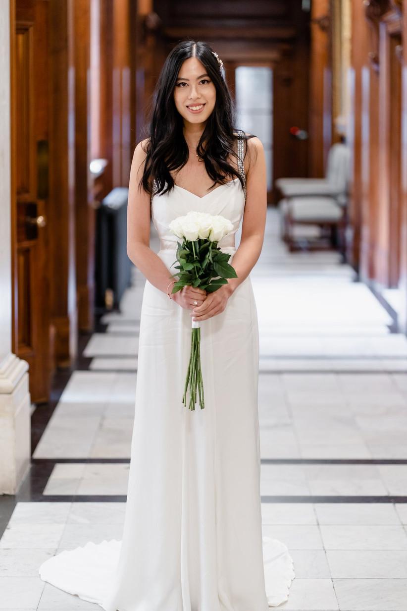 Bride outside wedding ceremony room