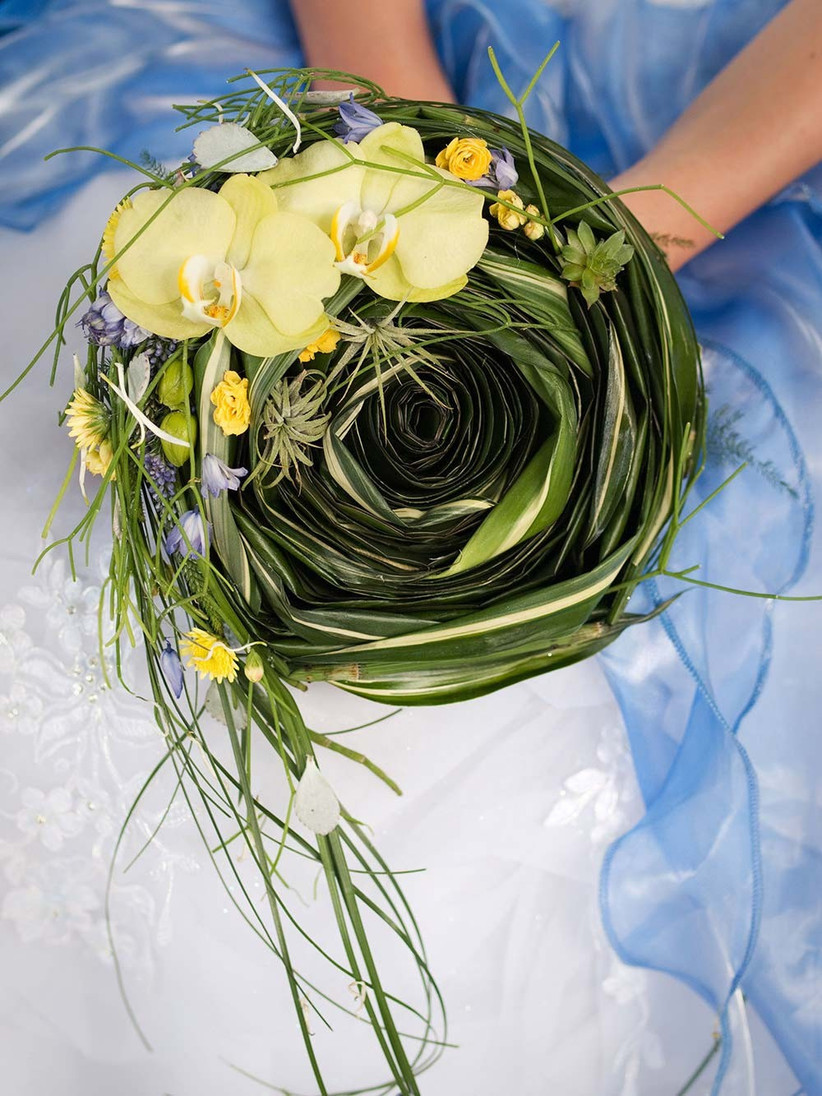 this-swirled-orchid-bouquet-would-be-perfect-for-a-summer-wedding-if-youre-selecting-seasonal-wedding-flowers