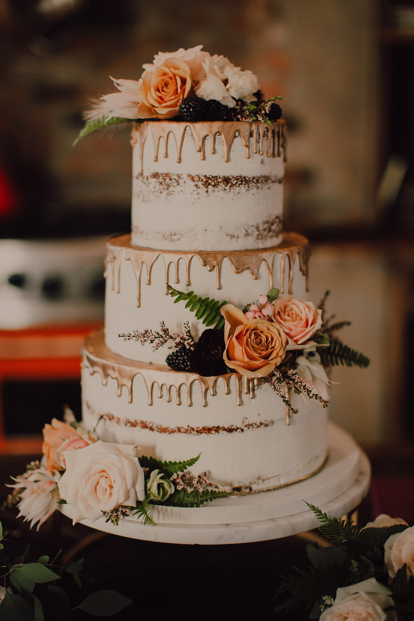 Naked white rustic wedding cake with gold drips