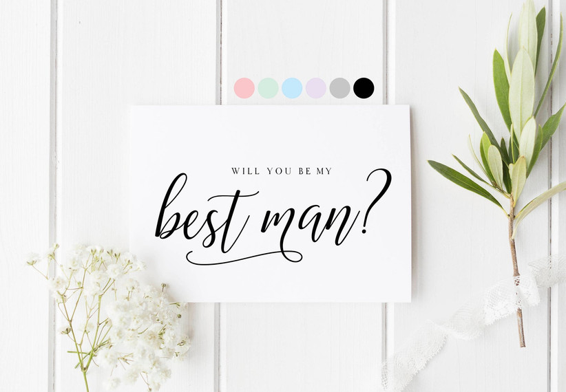 White card with a will you be my best man message written in calligraphy style writing